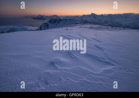 Winter dawn over mountain landscape from summit of Ryten, Moskenesøy, Lofoten Islands, Norway - Stock Image