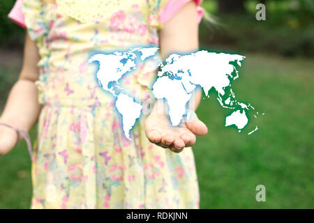 Child holding with hand earth map drawing. Global international concept. - Stock Image