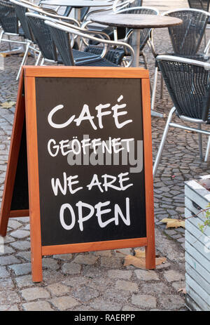 An open sign at a Berlin cafe - Stock Image