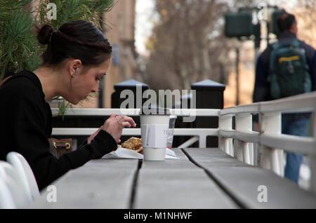 A woman takes a coffee break outside of a Sacramento cafe. - Stock Image