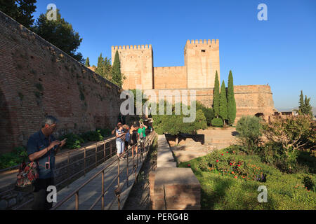 The towers of the Alcazaba or the Promenade of the Towers at The Alhambra Palace in Granada Spain - Stock Image