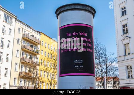 Berlin, Mitte. Litfaßsäule, Litfass column 1854 -2019. Cylindrical advertising columns invented by the German printer Ernst Litfass in 1854. - Stock Image