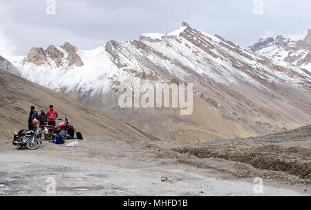 Leh Ladakh Exploring Motorists trek relaxing in the scenic Himalayan Mountain Landscape at Ladakh Kashmir India - Stock Image