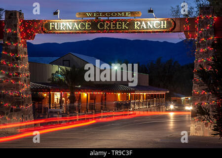 Entrance to Furnace Creek Ranch and light streaks, Death Valley National Park, California USA - Stock Image