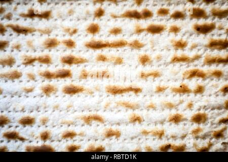 Jewish traditional Matso unleavened bread textured background, matso bread is made during the Jewish Passover Pesach holiday. Pesach concept greeting - Stock Image