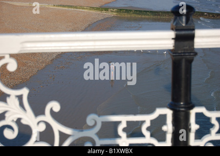 View of beach from Brighton Pier, East Sussex, England - Stock Image