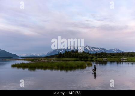 Man fishing with fishing rod, Katmai National Park, Alaska - Stock Image
