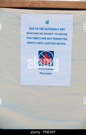 Notice restricting barbecues in Milton Park during dry season - Stock Image