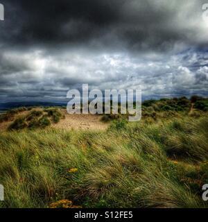 Sand Dunes & Storm Clouds - Stock Image