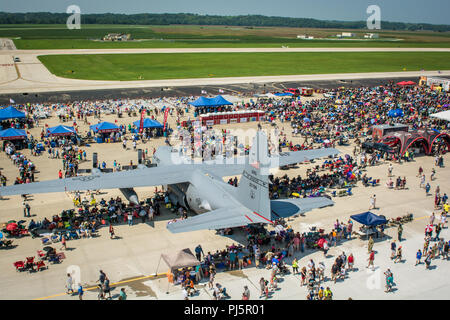 Community and service members tour a variety of military and civilian aircraft during the Sound of Speed Air Show, at Rosecrans Air National Guard Base, St. Joseph, Mo., August 25, 2018. The air show was hosted by the 139th Airlift Wing, Missouri Air National Guard and the city of St. Joseph to the thank the community for their support. The air show committee estimated 45,000 people attended the Saturday performance. (U.S. Air National Guard photo by Staff Sgt. Patrick Evenson) - Stock Image