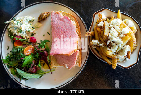 Café lunch Honey Roast  ham open sandwich with Pommery mustard salad and pickles with a side dish of Greek Chips with Feta cheese - Stock Image