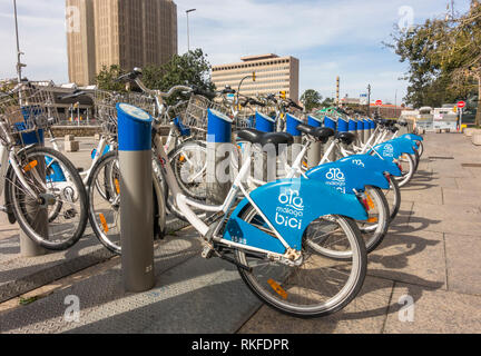 Malaga spain, Row of blue Malaga Bici, public bicycles renting system station in Malaga, Andalusia, Spain. - Stock Image