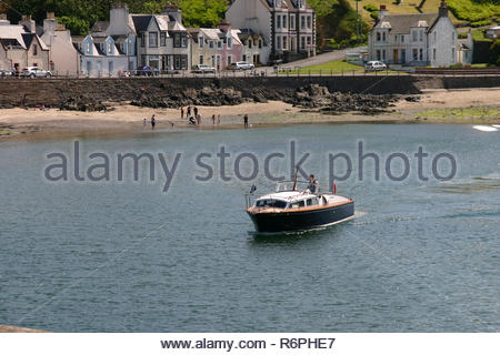 Boat arriving on a sunny day in Portpatrick, Dumfries and Galloway, Scotland, UK. - Stock Image
