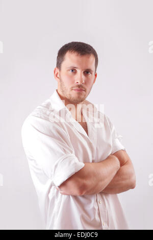 Man with white shirt over white background - Stock Image