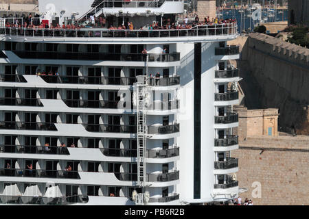 People on the stern of the cruise ship MSC Seaview while departing from Malta. Nine levels are visible, illustrating the size of modern cruise liners. - Stock Image