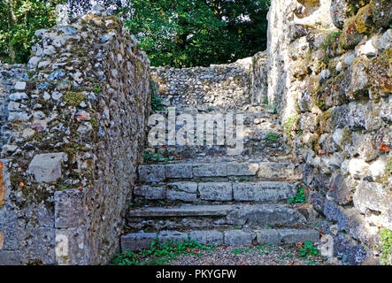 A view of steps at the west end of the ruins of the Norman Bishop's Chapel at North Elmham, Norfolk, England, United Kingdom, Europe. - Stock Image