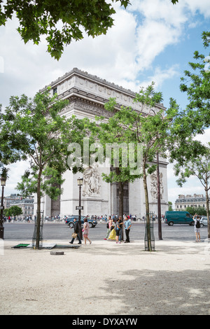 View of the Arc de Triomph behind some trees in Paris, France. - Stock Image