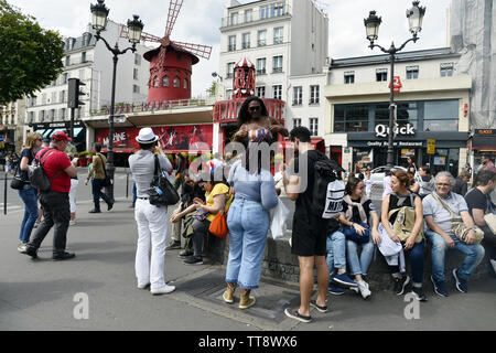 Tourists in front of the Moulin Rouge - Paris - France - Stock Image