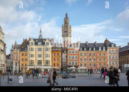 Main square or Grand Place (Place du Général de Gaulle) in Lille with the bell tower of the Chamber of - Stock Image
