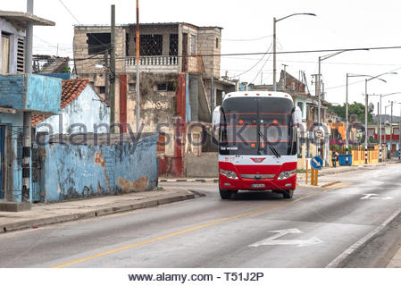 Yutong bus turning in Carretera Central. The land transportation vehicle is of Chinese production and it has Maple Leaves in the windshield as decorat - Stock Image