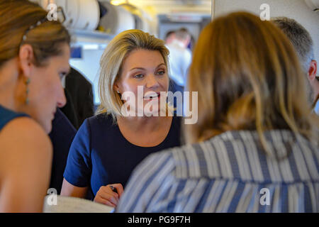 Secretary Michael R. Pompeo conducts airborne questions and answers with the traveling press en route to Singapore August 3, 2018. - Stock Image