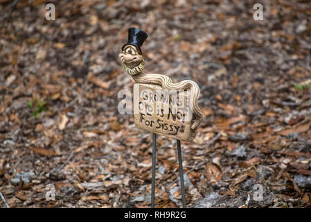 Growing Old is definitely not for sissys...so says this yard art in North Central Florida. - Stock Image