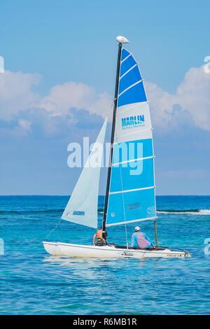 Hobie cat catamaran sails of a resort on the north coast of Cuba. - Stock Image