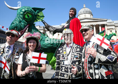 Trafalgar Square. London, UK. 20th Apr, 2019. A man dressed as St George on a dragon along with 'Pearly Kings and Queens' attends the annual 'Feast of St George' event in Trafalgar Square, to celebrate the Patron Saint of England. St George's Day is on 23 April. Credit: Dinendra Haria/Alamy Live News - Stock Image