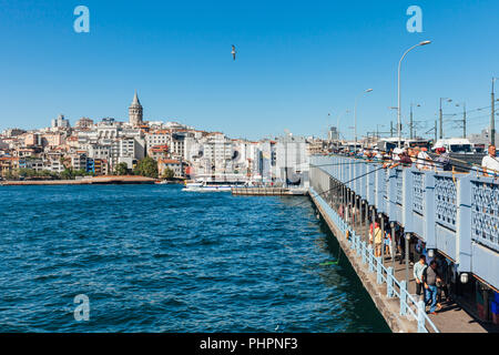 Istanbul, Turkey - August 14, 2018: Men catch fish from the Galata Bridge on August 14, 2018 in Istanbul, Turkey. - Stock Image