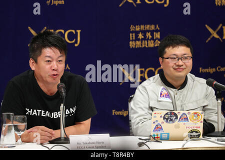 (L-R) Interstellar Technologies Inc. founder Takafumi Horie and CEO Takahiro Inagawa attend during a press conference at the Foreign Correspondents' Club of Japan in Tokyo on May 15, 2019. A Japanese aerospace startup successfully launched a small unmanned rocket MOMO-3 earlier this month, making it the country's first privately developed model to reach the outer space. Credit: Yohei Osada/AFLO/Alamy Live News - Stock Image