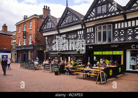 The independant bookshop and cafe with Enzo cafe next door in Elizabelthan wooden framed buildings in Nantwich, Cheshire, UK - Stock Image