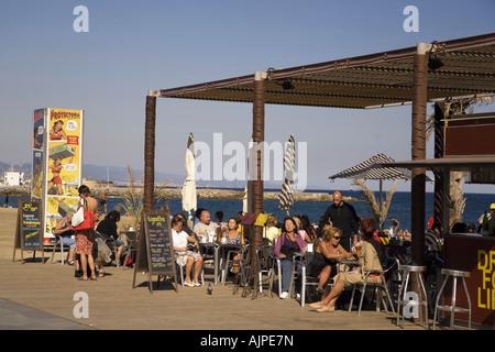 Spain Barcelona beach Platja de la Barceloneta people beach bar - Stock Image