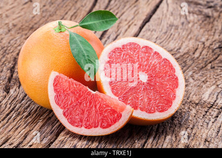 Grapefruits on old wooden background. - Stock Image