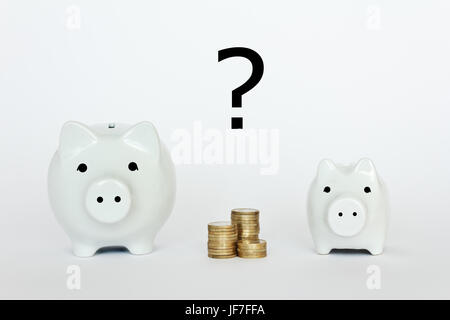 2 white porcelain piggy banks, one small, one big, with a pile of coins and a question mark - Stock Image