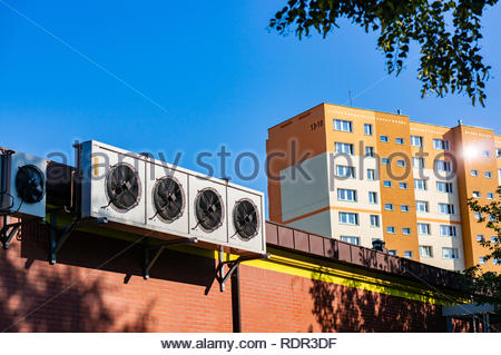 Poznan, Poland - July 20, 2018: Outdoor units of split-system air conditioners of a Biedronka supermarket with a apartment block in the background on  - Stock Image
