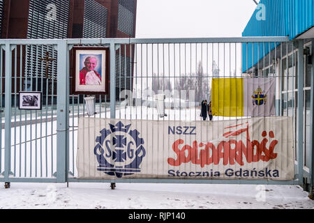 Entrance sign to Gdansk shipyard with poster of Pope John Paul II, European Solidarity Centre museum, Plac Solidarności, Gdańsk, Poland - Stock Image