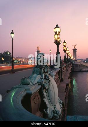 France Paris Pont Alexandre III Laterne sculptures at dusk - Stock Image