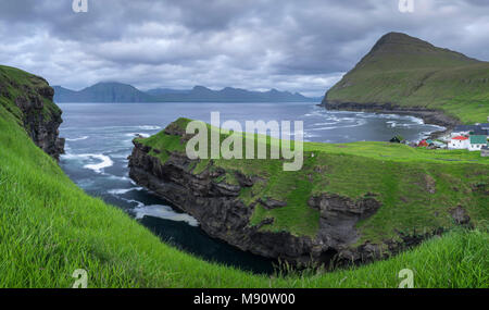 Cliff top view over the gorge at Gjogv towards the island of Kalsoy, Eysturoy, Faroe Islands, Denmark. Summer (June) 2017. - Stock Image