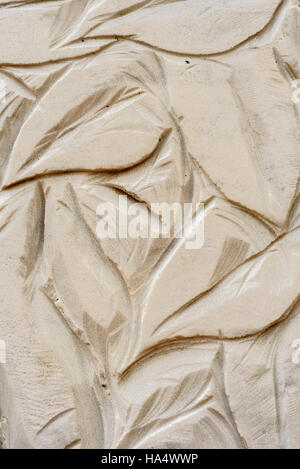 Closeup macro image of stone carvings of a granite material statue - Stock Image