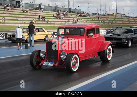 A hot rod car parading during a classic car event. - Stock Image