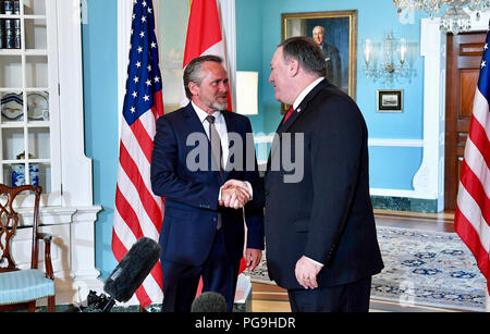U.S. Secretary of State Mike Pompeo and Danish Foreign Minister Anders Samuelsen shake hands at the U.S. Department of State in Washington, D.C., on May 25, 2018. - Stock Image