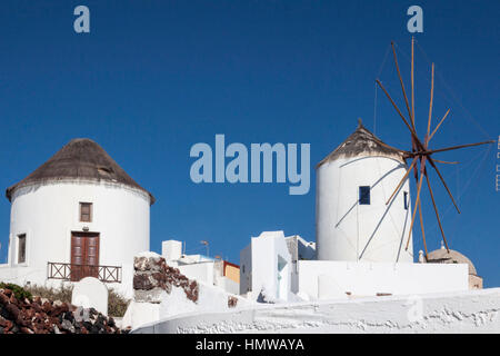 Typical Windmill and Whitewashed house in Oia, Santorini, Greece - Stock Image