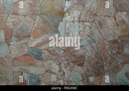 photo of background of colored stone wall surface - Stock Image