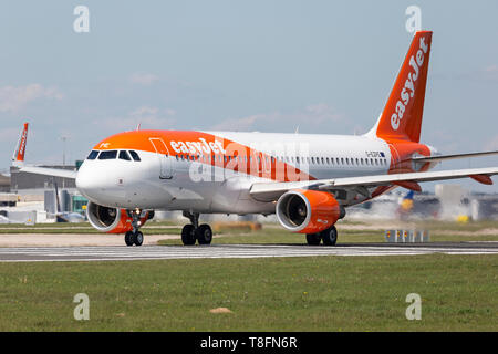 Easyjet Airbus A320-200 aircraft, registration G-EZPE, preparing for take off from Manchester Airport, England. - Stock Image
