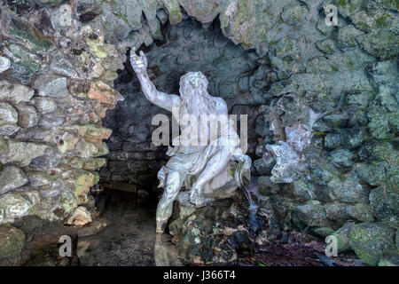 a statue of neptune in a cave - Stock Image