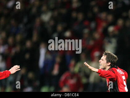 Manuel Friedrich (R) of Leverkusen celebrates the 1-0 during the UEFA Cup group E match Bayer Leverkusen v Sparta - Stock Image