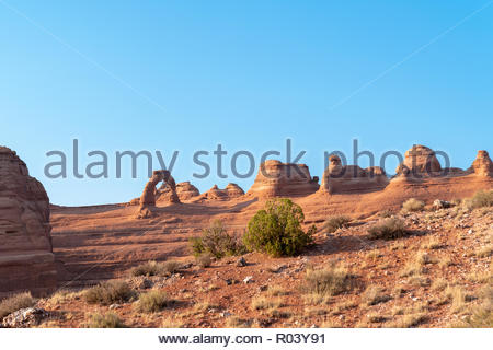 Delicate Arch, Arches National Park, Utah This unconventional view of Utah's iconic Delicate Arch shows it standing high on the top of sandstone mesa - Stock Image