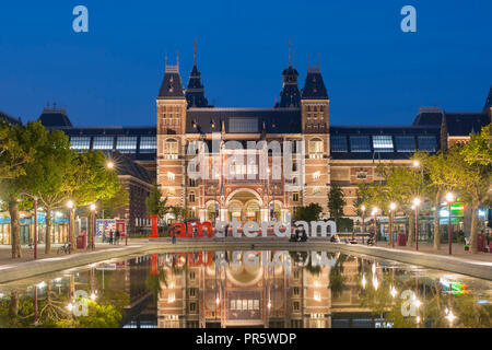 Rijksmuseum Amsterdam, Netherlands, with paintings of Rembrandt (for example 'Night Watch') on square Museumplein. Architect Pierre Cuypers. - Stock Image