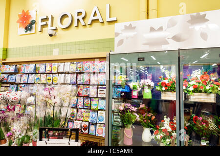 Miami Beach Florida Publix Grocery Store supermarket inside display sale flowers mylar balloons floral display - Stock Image