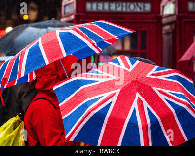 Union Jack Umbrellas in the rain in London - Stock Image